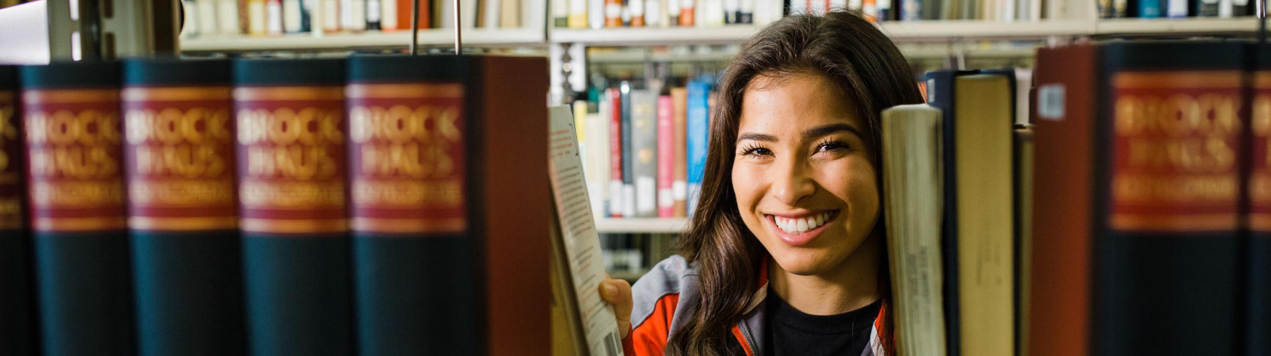 Student Behind bookshelves
